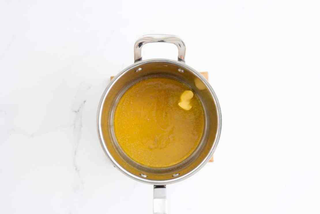 Butter and honey in the bottom of a large saucepan.