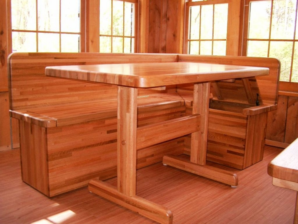 Wooden kitchen table with bench Photo