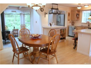 View of the Dining room into the Kitchen and Sunroom.