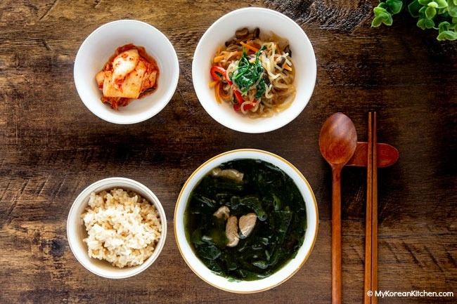 Miyeok guk served with rice and other side dishes