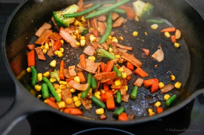 Easy Fried Rice - cooking vegetables with the sauce