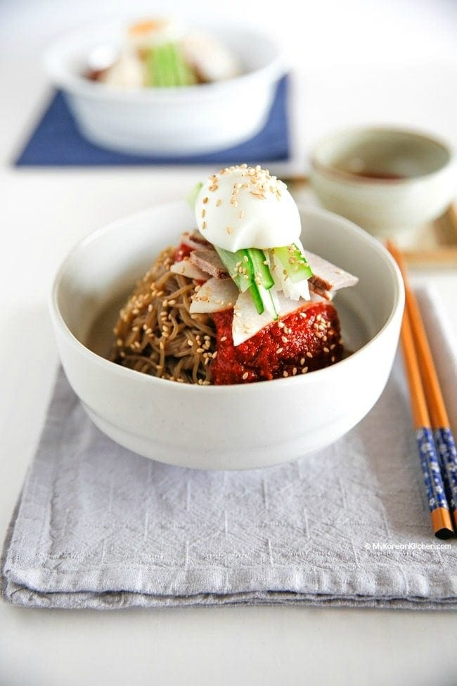 Bibim Naengmyeon is a perfect way to beat the summer heat! It's cold, spicy, sweet and tangy. Everything you need is all in one bowl! | MyKoreanKitchen.com