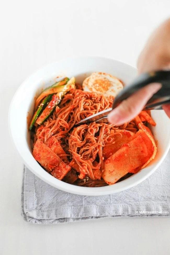 How to eat Bibim Naengmyeon (Korean spicy cold noodles) | MyKoreanKitchen.com