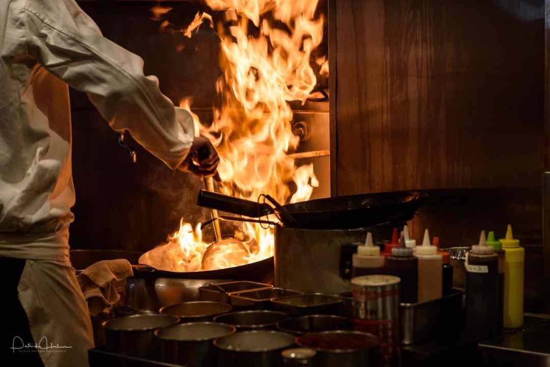 Admiring the skill of the chef at a Ramen/Gyoza restaurant