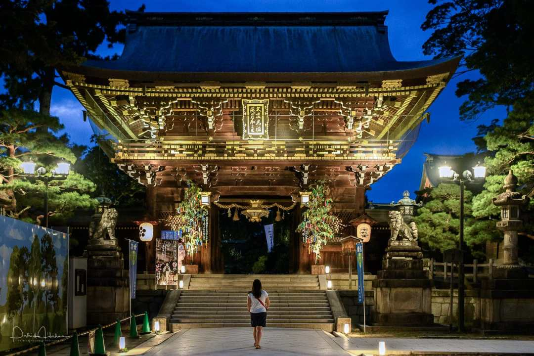 The massive shrine gate illuminated during the Kitano Tanabata Festival
