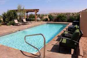 if you are going to have a pool in New Mexico this is a lovely way to do it. Beautiful blue water against the gorgeous 360 views of Placitas. But what I really love about it is the stamped colored concrete. There are so many things you can do with concrete. This is just one option and it really works.