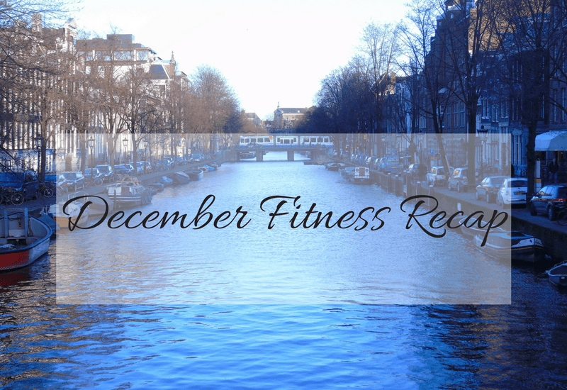 December fitrness recap written over the top of a view of one of the Amsterdam canals.