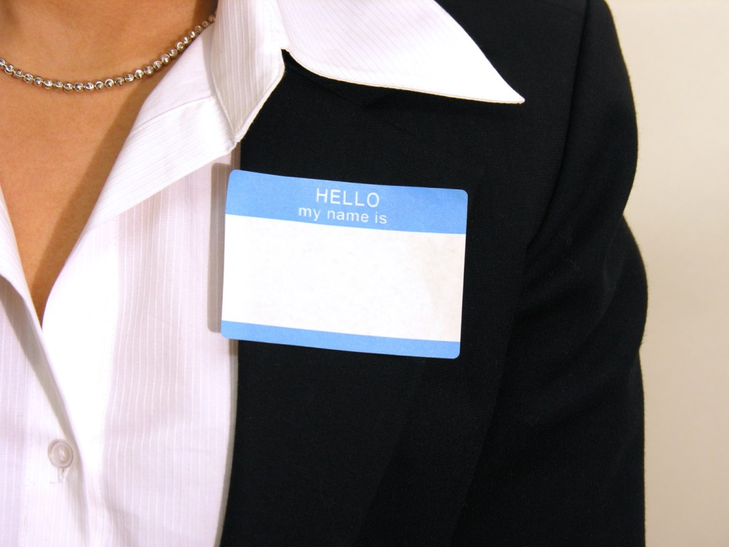 close up of woman with name tag