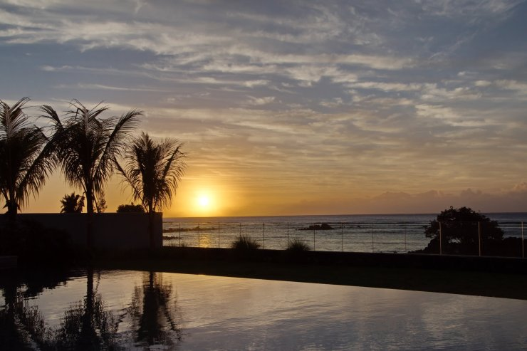 Sunset reflection on the swimming pool, Pointe aux Biches, Mauritius 2019