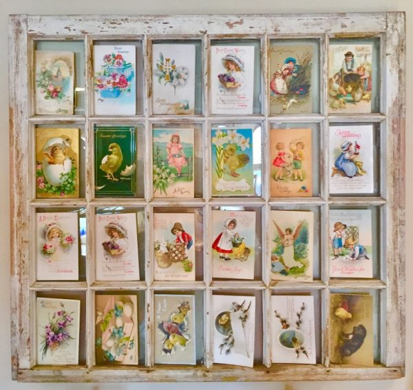 Vintage creeting card display in an old window #DIY