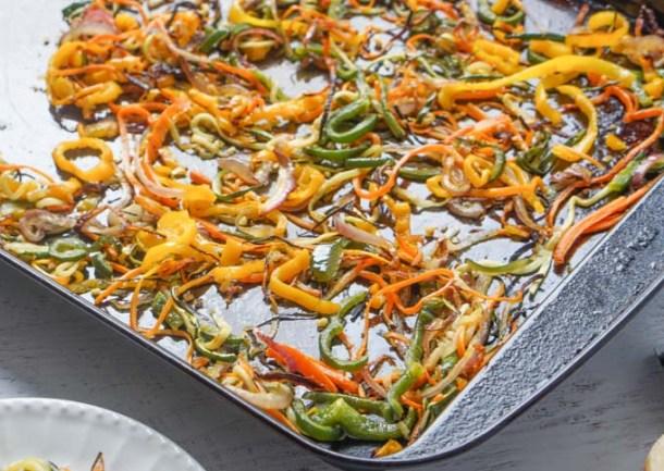 Baked veggie noodles on baking tray.