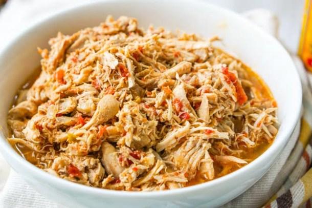 white bowl of cooked salsa chicken shredded