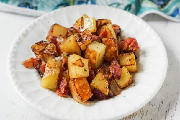 white plate with German fried potatoes with bacon