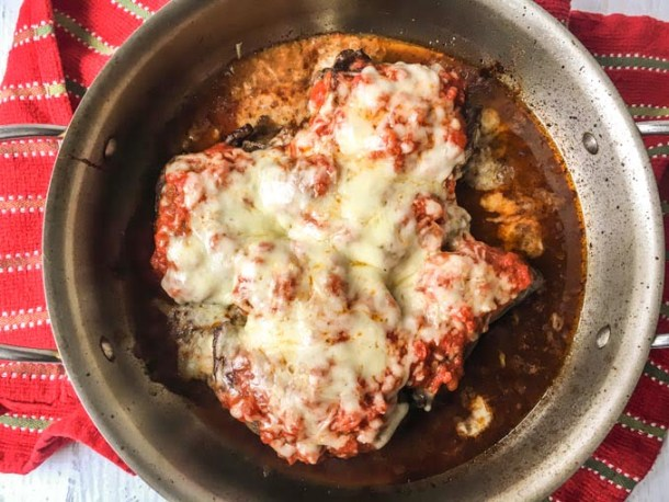 These cheesy pizza beef rollups are a fun and delicious low carb dinner you can make with one pan. Thin beef steaks are stuffed with melty, gooey cheese and topped with low carb sauce to make a tasty weeknight meal.