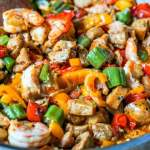 This low carb cajun stir fry dinner is full of flavorful ingredients like chicken, shrimp and sausage. You can make this one pan dinner in under 30 minutes and there is just 5.1g net carbs per serving!