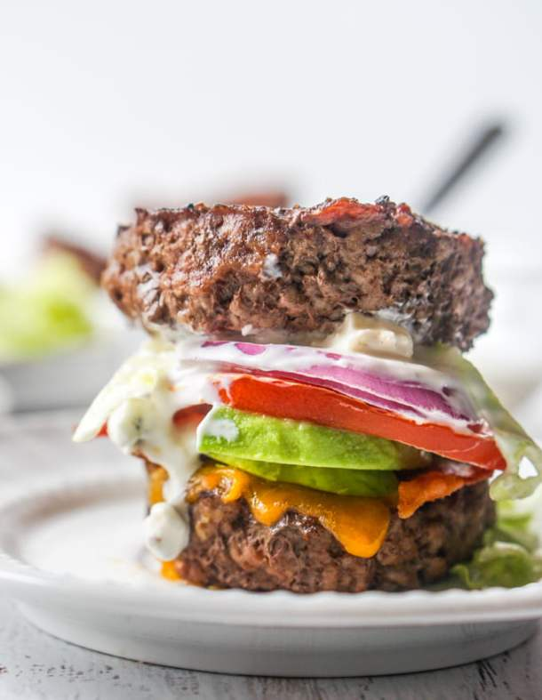 Long photo of closeup of keto version of a Fat Tuesday burger on white plate.