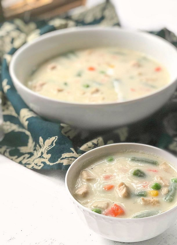 white bowls with low carb creamy turkey soup  and green tea towel