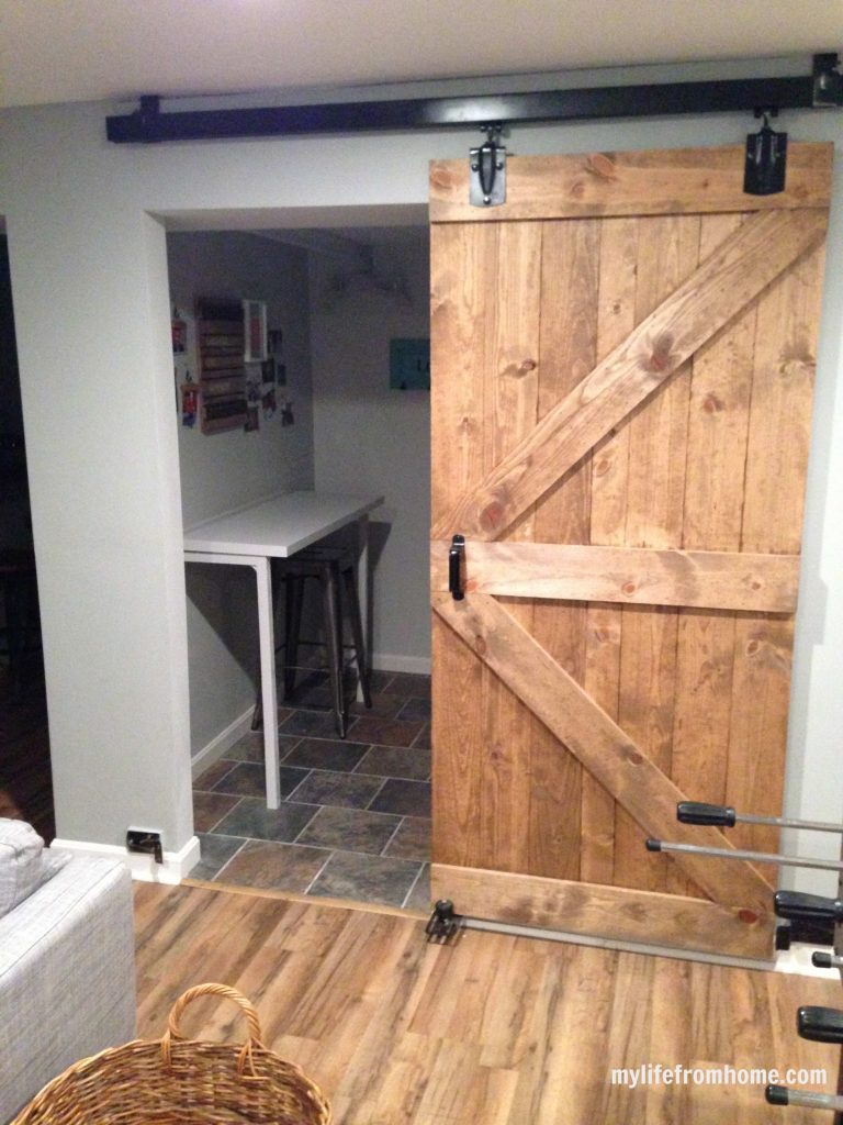 Sliding barn door into laundry room