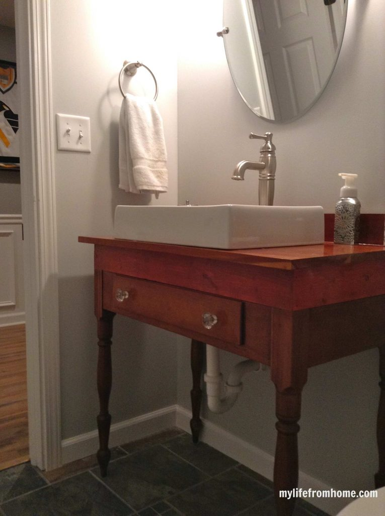 Finished vanity Antique Table with Sink by www.whitecottagehomeandliving.com
