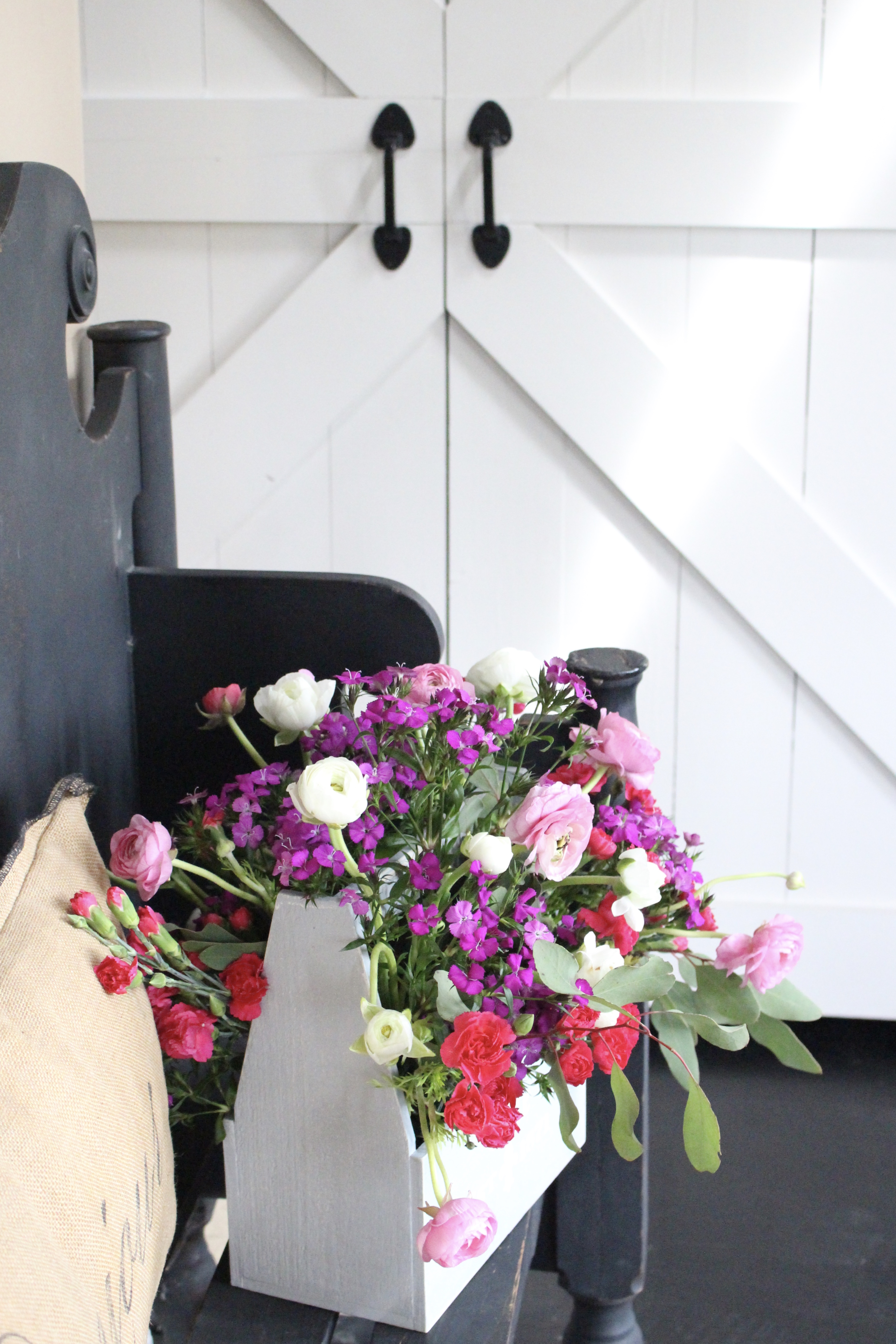 Toolbox Crate Flower Arrangement- spring flower- arranging flowers- how to arrange flowers- unusual flower vessels- arranging flowers- spring decor- flower boxes