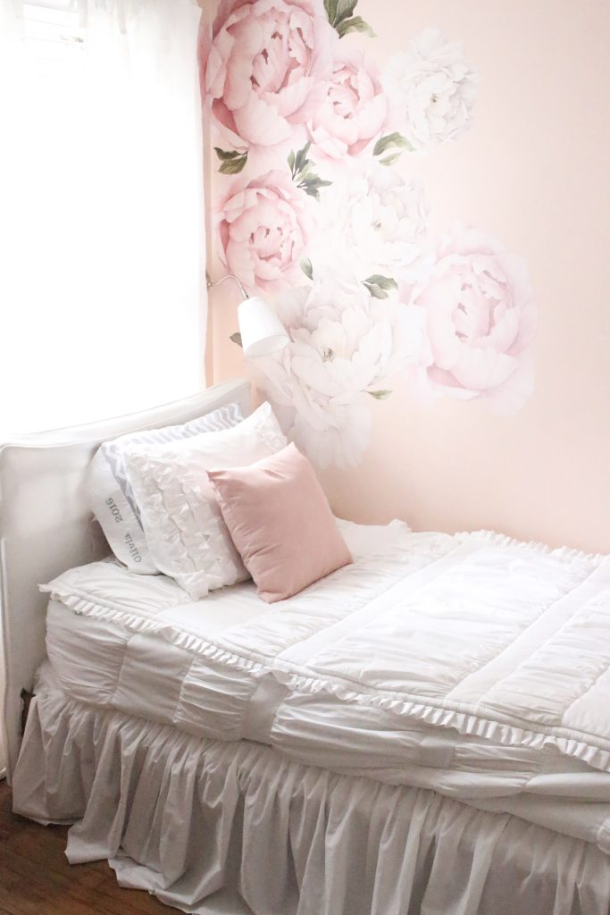 Sweet & Feminine Tween Girl bedroom space- kids bedrooms- girl bedrooms- flower wall decals- white ruffled bedding- pink room- home design- home decor- wall decor ideas- bedroom decor ideas- white bedding- peony wall paper- flower wallpaper decals- blush walls- Beddy's bedding- zip up bedding- pink and gray- removable wall decals- teen bedroom- home decor- DIY