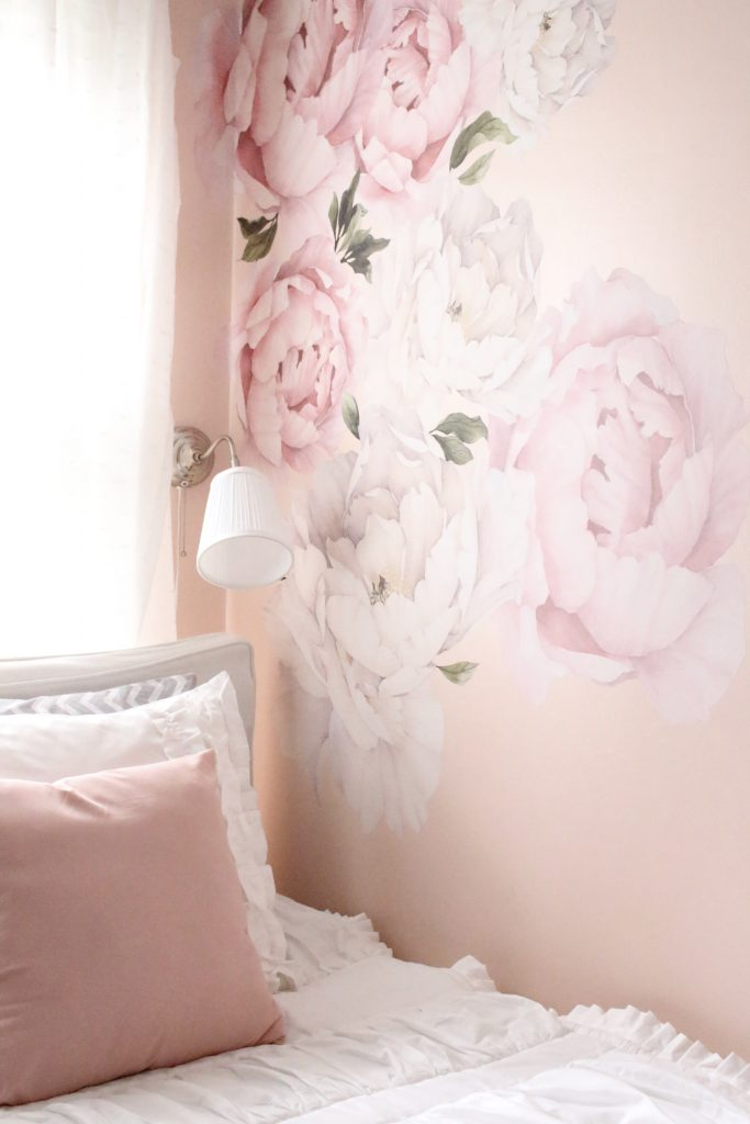 Sweet & Feminine Tween Girl bedroom space- kids bedrooms- girl bedrooms- flower wall decals- white ruffled bedding- pink room- home design- home decor- wall decor ideas- bedroom decor ideas- white bedding- peony wall paper- flower wallpaper decals
