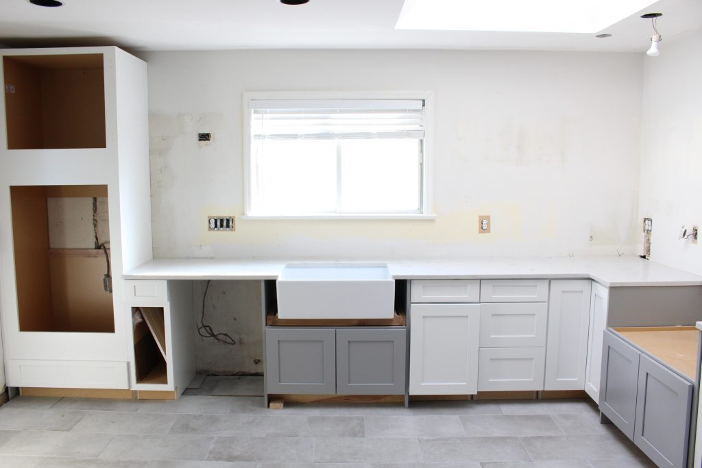 White and Bright Cottage Kitchen Makeover- new cabinets- kitchen- quartz countertops- renovation- DIY- updated counters- white cabinets- gray cabinets- home decor- kitchen design- farmhouse kitchen
