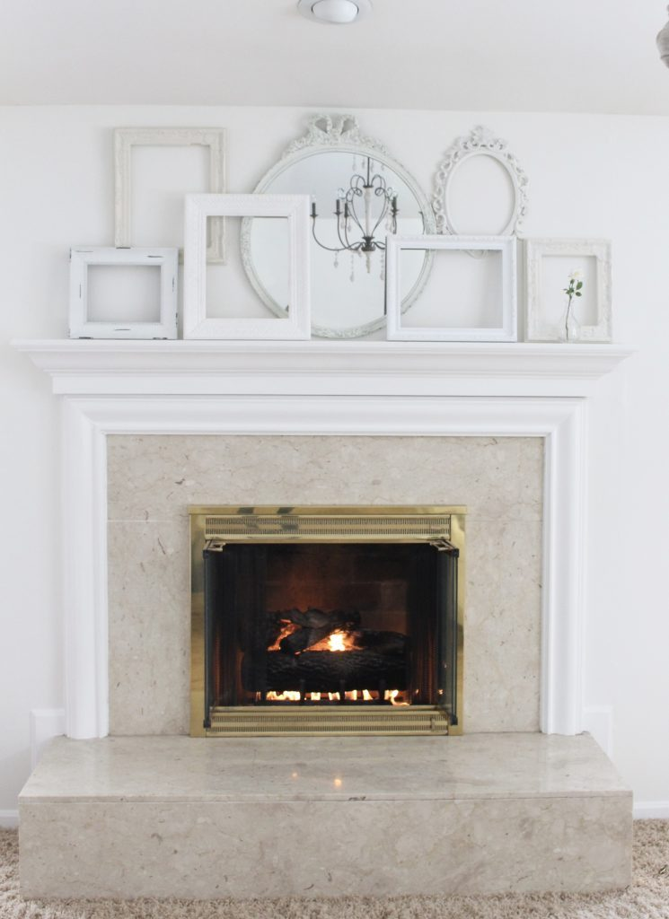 A shabby chic white mantel- layered frames- white mirror- all white decor- romantic design- fireplace decor- mantel decor- home design- decor ideas- mantles- french country style mantel- DIY- Do it Yourself- DIY projects- room design- wall decorating ideas- gallery wall- room decor ideas- decoration ideas