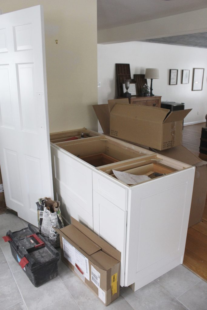 Warm and Inviting White Cottage Kitchen Renovation Update- Halfway mark of the kitchen reno- white and gray kitchen cabinets- home design- farmhouse sink- hutch- Woodmark- Home Depot cabinets- DIY- DIY projects- renovations- home design ideas- built in hutch- pennisula