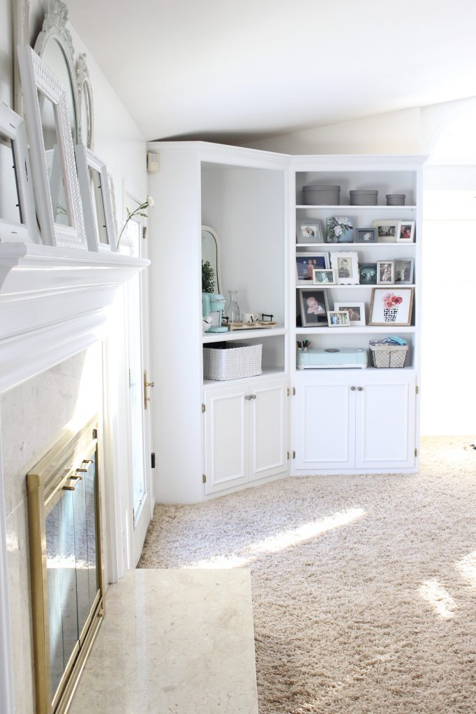 White Cottage Style Bedroom with bookcases- shabby chic style- cottage style- coffee station- bedroom design- how to style a coffee station- bookcase- DIY- DIY projects- Keurig- mint green coffee maker- white bedroom decor- room design- styling a bookcase- coffee tray- white mirror- farmhouse decor- farmhouse style coffee station- french country style- mini Keurig