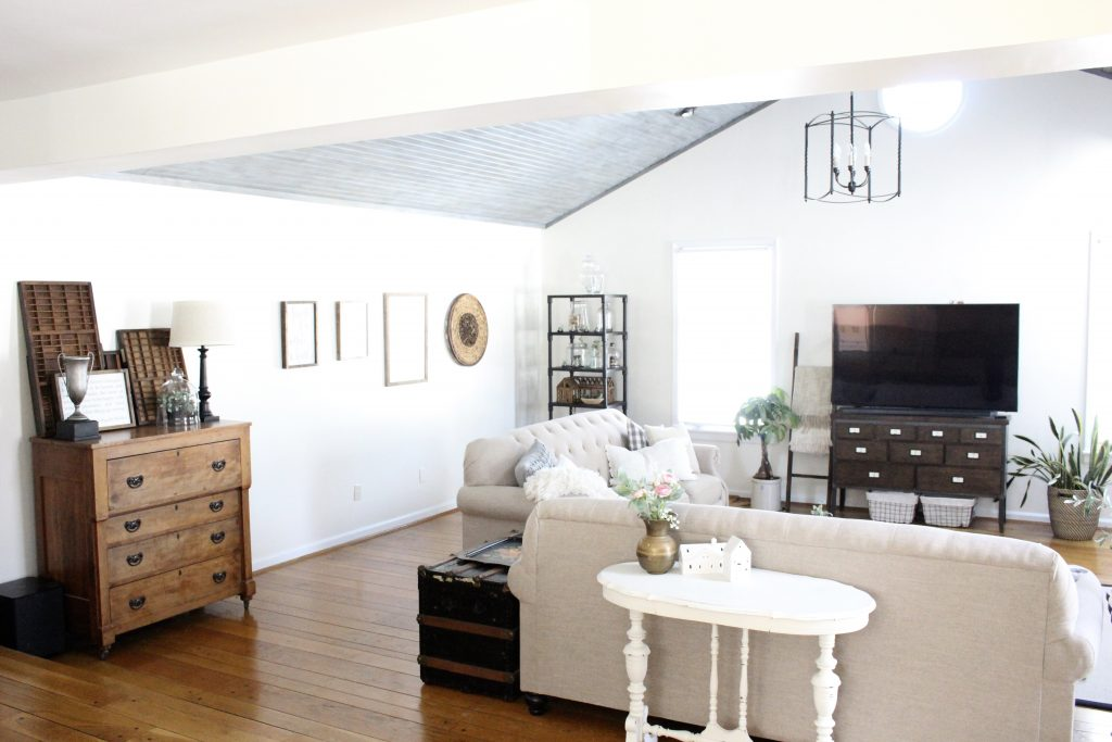 Gray and White Cottage Living Space- farmhouse style room- decor- DIY- weathered wood ceiling treatment- painted ceiling- paint and stain treatment on pine- how to- paint- stain- wood- ceiling- winter decor- room design- home decor- living room decorating ideas- rustic home decor- wall decorating ideas- decoration ideas- room decor ideas- mantel ideas- french county style decor-tv room- designing a large room
