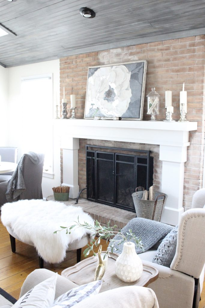 Gray and White Cottage Living Space- farmhouse style room- decor- DIY- weathered wood ceiling treatment- painted ceiling- paint and stain treatment on pine- how to- paint- stain- wood- ceiling- winter decor- room design- home decor- living room decorating ideas- rustic home decor- wall decorating ideas- decoration ideas- room decor ideas- mantel ideas- french county style decor-tv room- flower painting