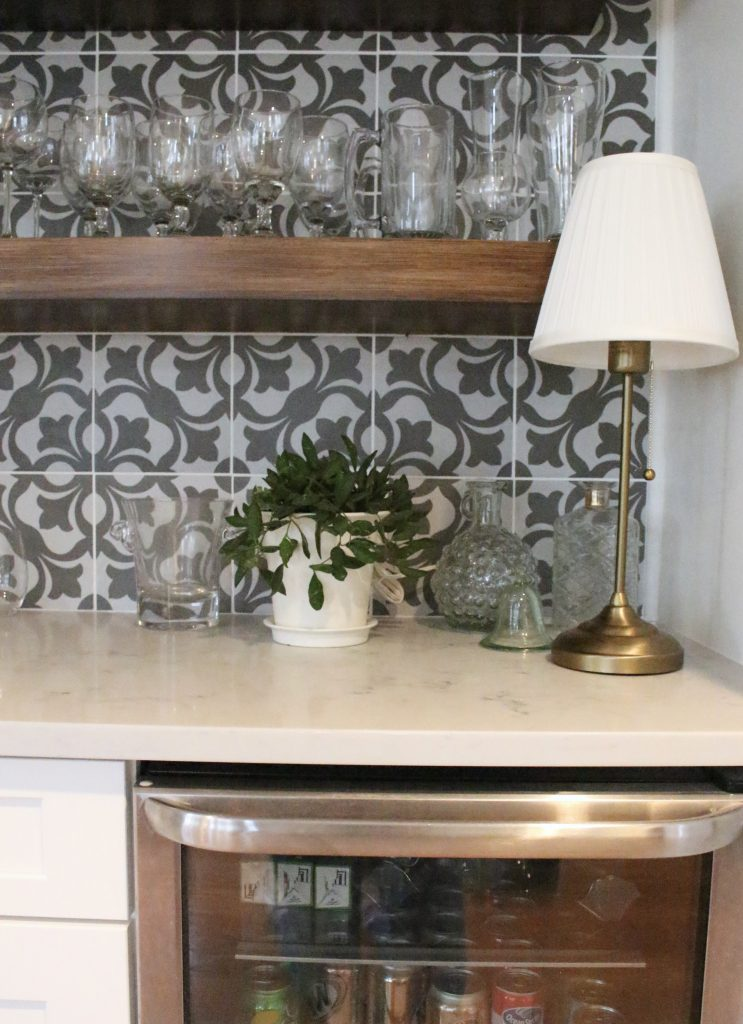beverage center- bar nook- DIY- bar area- kitchen- pattern tile on the wall- cottage renovation- kitchen renovation- cottage kitchen- farmhouse style kitchen- room decor ideas- DIY projects- floating wood shelve- brass lamp