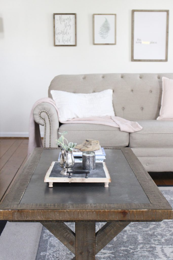 Spring Family Room- Spring Decor- Blush Tones- Pink- Adding spring decor- home design- DIY- decorating ideas for spring- pastel decor- spring- seasonal decor- family room- living spaces- wall decorating ideas- fireplace decor- coffee table decor