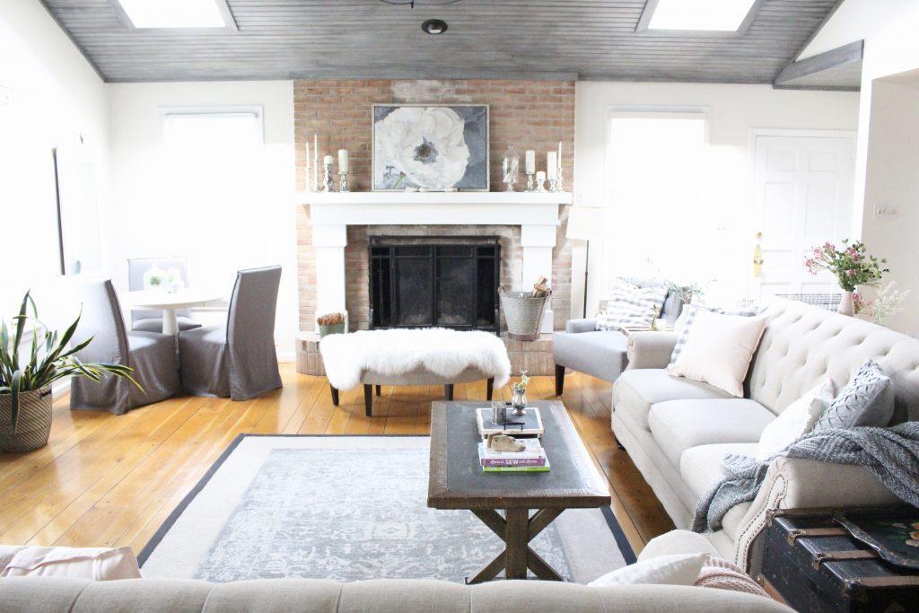 Spring Family Room- Spring Decor- Blush Tones- Pink- Adding spring decor- home design- DIY- decorating ideas for spring- pastel decor- spring- seasonal decor- family room- living spaces- wall decorating ideas- fireplace decor- decorating a large space
