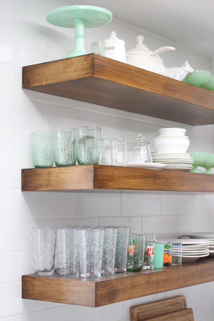 White- Cottage Kitchen- Renovation- Reveal- kitchen design- kitchen decorating ideas- kitchen decor ideas- room design- home decor- design- open shelving- custom island- white cabinets- professional appliances- DIY- Do it Yourself- wood range hood- cottage design- farmhouse kitchen- gray cabinets- open shelves in a kitchen- wood shelving