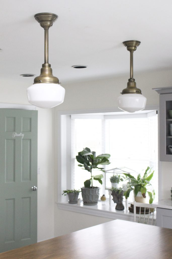 schoolhouse lighting- milk glass lighting- kitchen renovation- pendant lights- vintage- cottage style- farmhouse style- wood and white- antique brass lights