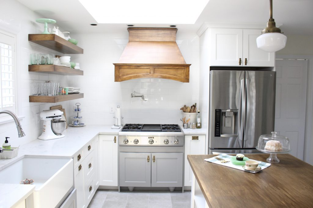 Kitchen- remodel- makeover- cottage kitchen- farmhouse kitchen- mix and match cabinets- wood hood- professional appliances- open shelving- schoolhouse lights