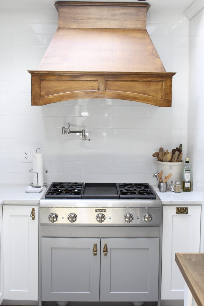 White- Cottage Kitchen- Renovation- Reveal- kitchen design- kitchen decorating ideas- kitchen decor ideas- room design- home decor- design- open shelving- custom island- white cabinets- professional appliances- DIY- Do it Yourself- wood range hood- cottage design- farmhouse kitchen- gray cabinets- Thermador professional range with griddle