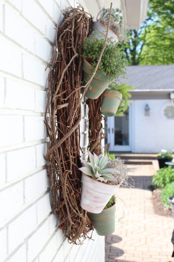 Outdoor succulent garden wreath- living wreath- grapevine wreath- hanging pots- succulents- outdoor- decor-garden- wreath with pots- plants- painting teracotta po