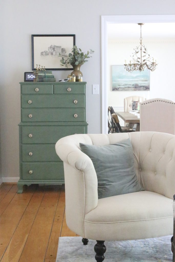 A multifunctional- living room- office- room design- tour- A wood dresser painted green- Amy Howard paints- One step paint- green- Cherbourg- how to use chalk paint- chalk painted finish- green furniture- how to paint furniture- home design- DIY- Do it Yourself project- painted furniture- crystal knobs- gray walls- antique pieces- drawing prints