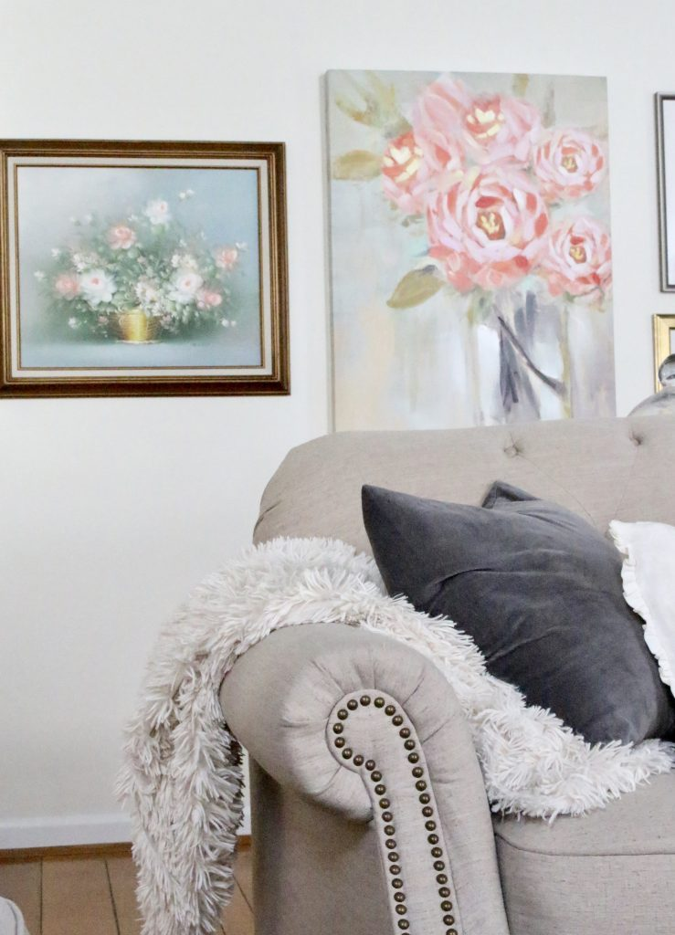 A new gallery wall in our family room- pastels- paintings- gallery wall- arrangement- wall decor- artwork- pale colors- neutrals- updated wall art- antique art- vintage art