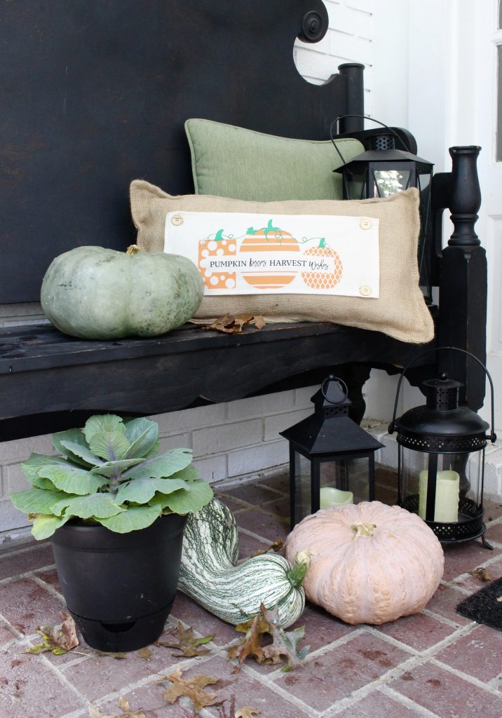 White brick ranch home- fall decor- decorating a small porch for fall- cottage home- outdoor decorating- home design- autumn decor- pumpkins- mums- front porch- handmade wreath- decorating with black and white- seasonal pillow