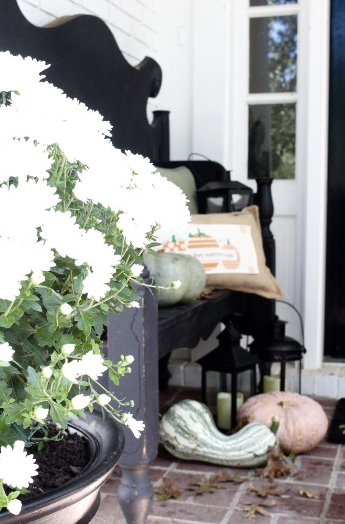 White brick ranch home- fall decor- decorating a small porch for fall- cottage home- outdoor decorating- home design- autumn decor- pumpkins- mums- front porch- handmade wreath- decorating with black and white- interchangable pillow- seasonal pillow
