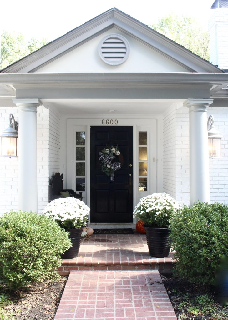 White brick ranch home- fall decor- decorating a small porch for fall- cottage home- outdoor decorating- home design- autumn decor- pumpkins- mums- front porch- handmade wreath- decorating with black and white
