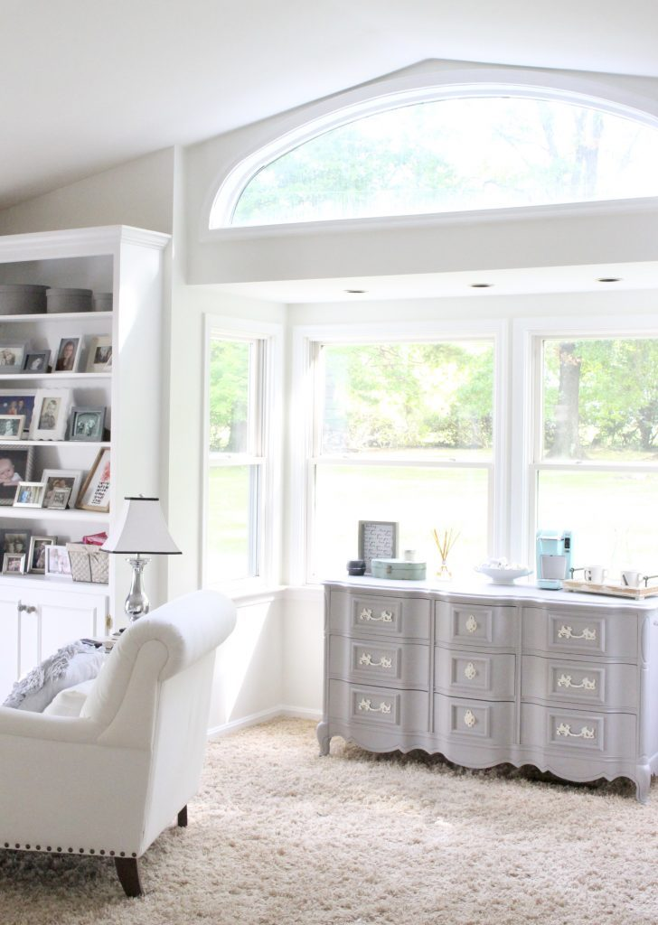 White Cottage Master Bedroom- gray- white- green- shabby chic bedroom- farmhouse decor- layered mirrors- painted gray furniture- DecoArt- Repose Gray- white bedding- white painted furniture- Armoire- fireplace in the bedroom- home design- large bedroom space- sitting area in the bedroom