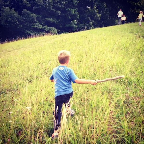 boy-running-in-field