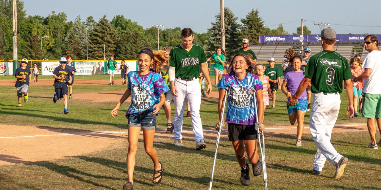 The Kids Were Scrambling to Get Off the Field before the Dawgs Took on the Mohawks