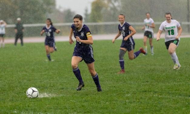 Girls varsity soccer team shuts out Herkimer in rain-shorted game