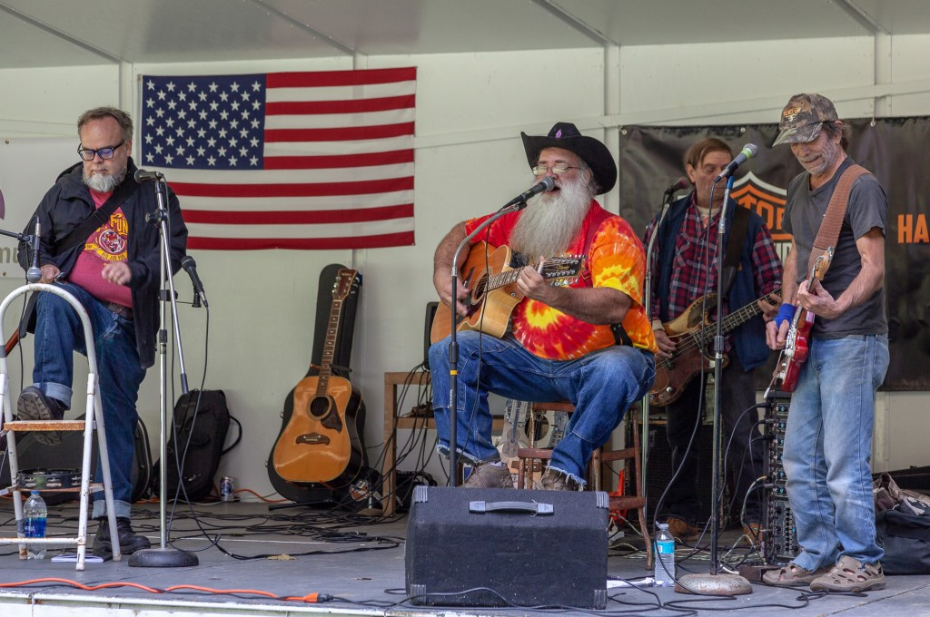 """Photo by Dave Warner - Rope Smokin' Roy """"The Hair Farmer"""" and his Orphans of the Storm perform at the 2018 Bluegrass, Bikes & BBQ Festival at Moreland Park."""